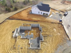 Several home sites in various stages of construction - aerial drone photography