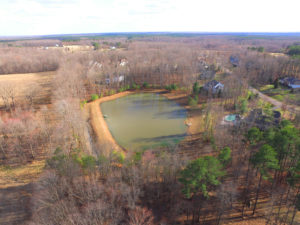 Aerial drone photography shot of a neighborhood lake in Spotsylvania County